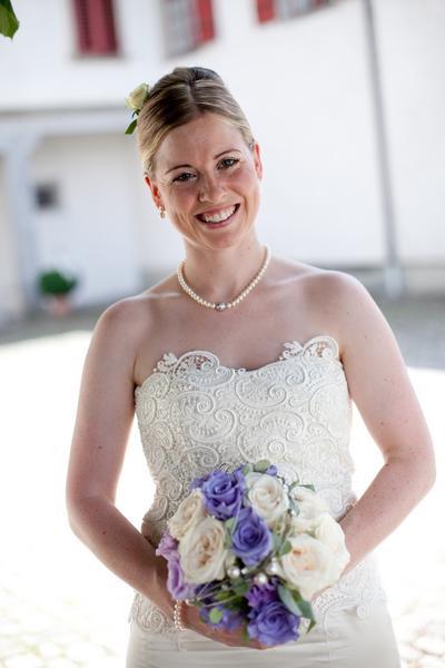 Hochzeitskleid in Seide und edler Guipure-Stickerei